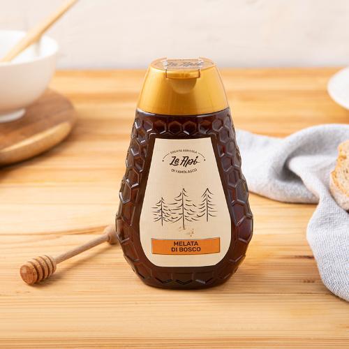 Squeezer di miele di melata di bosco